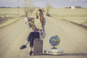 Content is the 1000 word journey. Girl sitting with her luggage, map, globe etc ready to explore the worlds beyond.